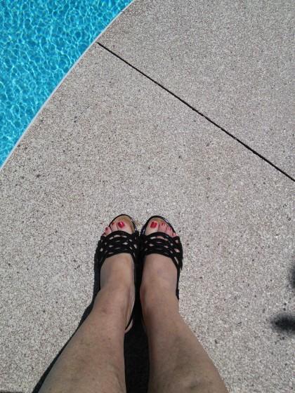 Sitting poolside in matching footwear