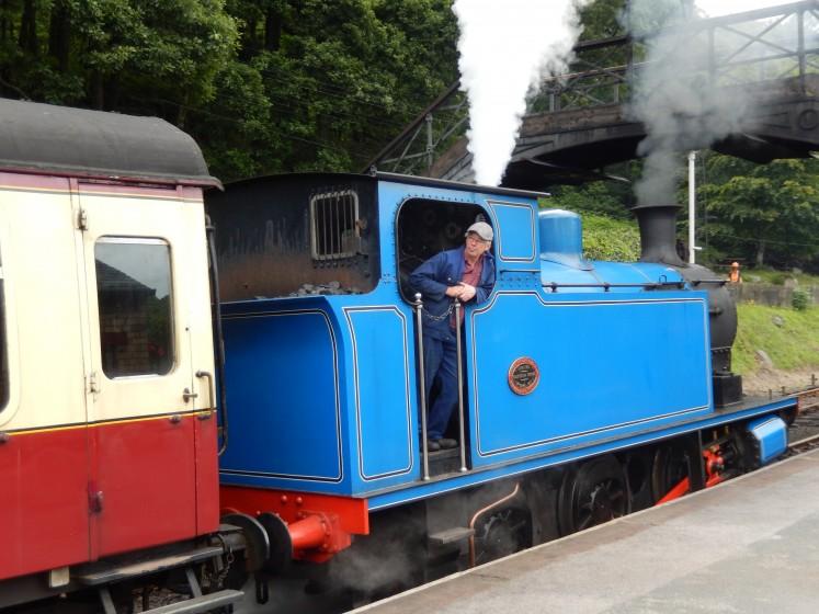 Steam train taking off