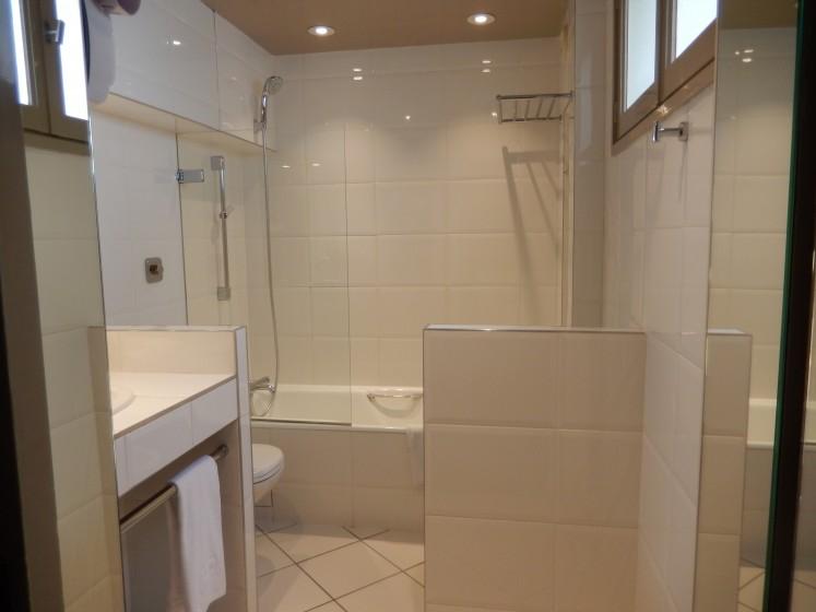 Very European bathroom off the bedroom. The bidet is behind the half wall.