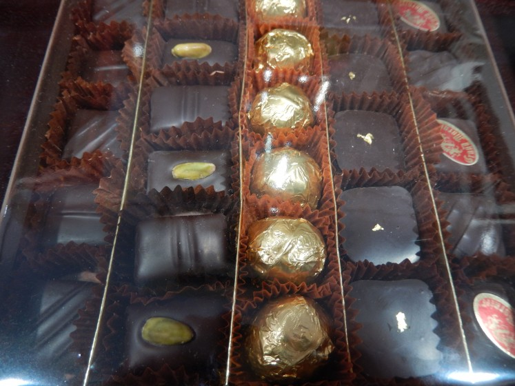 The candy in the second row from the right is decorated with edible gold. We bought a few pieces of another kind of candy and agreed it was the best chocolate we've ever had.