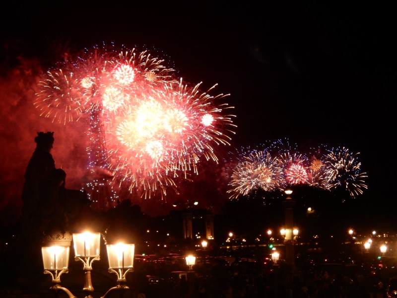 You can see the Eiffel Tower through the fireworks on the left.