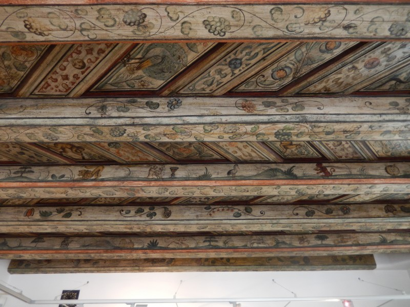 Eating a sweet roll was no hardship to get a good look at this ceiling artwork.