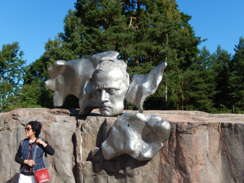 A sculpture of Sibelius, complete with Asian tourist.