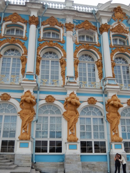The front of Catherine's Palace has statues of Atlas holding up the pillars for the second floor of the building.