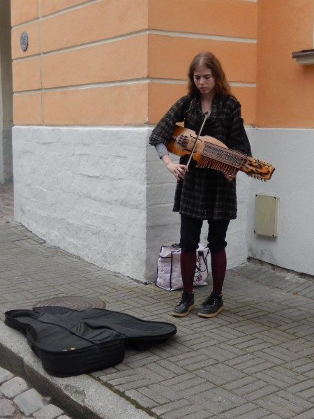 What kind of instrument is she playing?