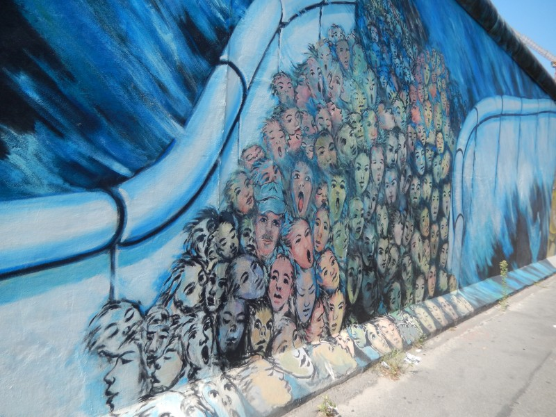 Some of the Wall was left standing and citizens were invited to paint murals on it. This portion portrays the stream of people coming through the crumbled Wall.