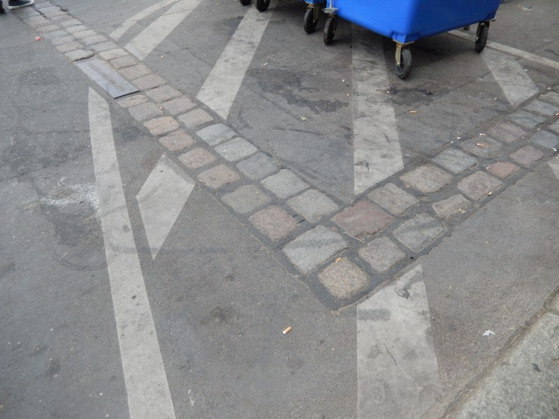 The double row of bricks marking the placement of the 90 miles of the Berlin Wall.