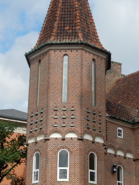 There are nine pigeon holes on each face of the tower, just below the long narrow windows.