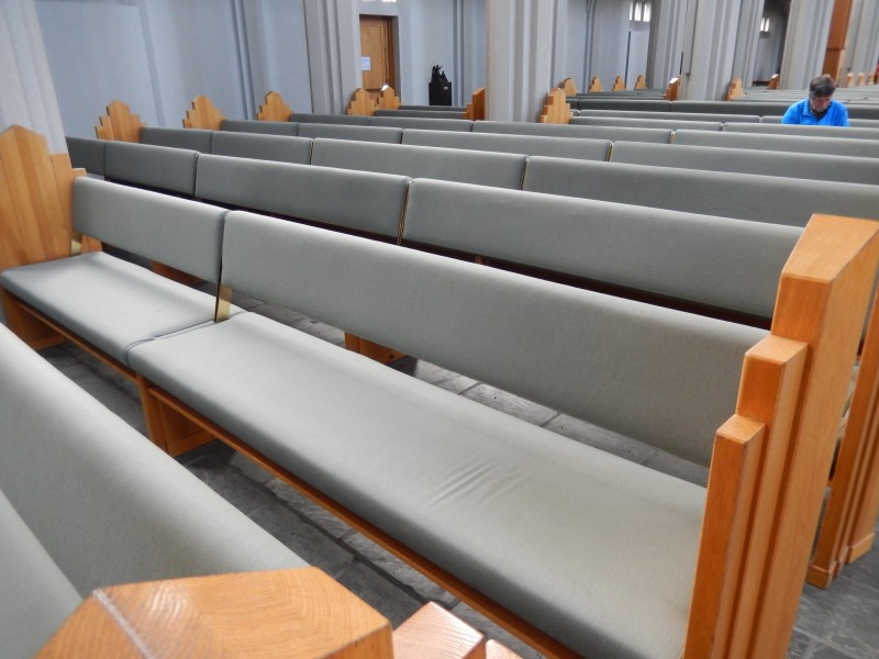 The pulpit is in the front; the huge pipe organ is in the back. The seat backs on the pews can be flipped to allow the congregation to face the altar for worship or the organ for concerts.
