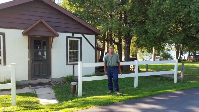 Jake in front of his cottage. He has park-like property across from the cottage and it's beautiful!