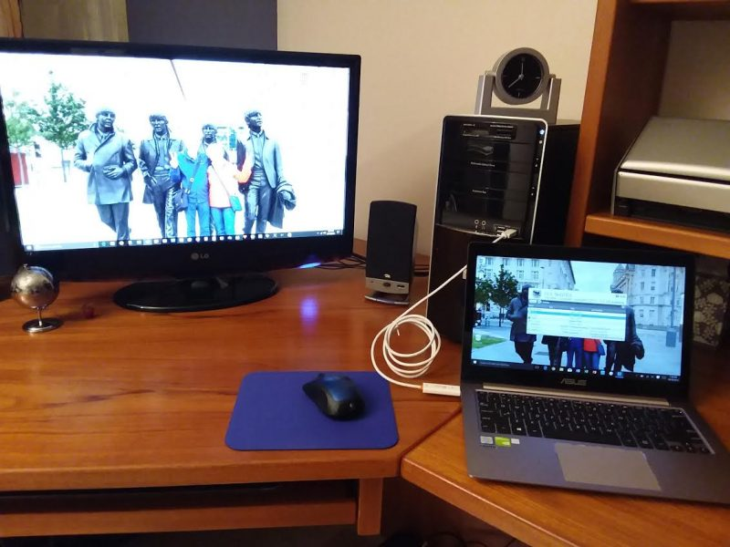 Two computers, one wormhole cable, and one mouse.  Awesome!
