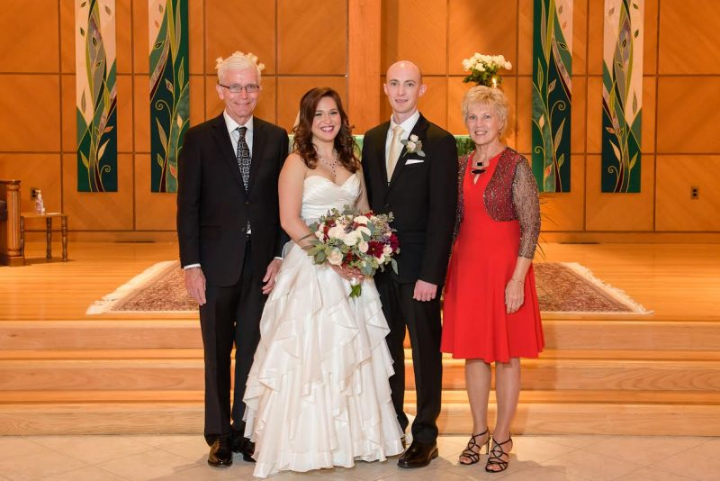 Bride and groom with favorite aunt and uncle.
