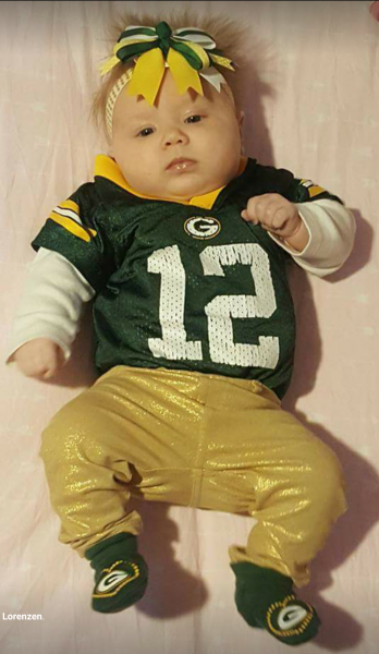 Barely a month old and already dressed in Packer green and gold from head to toes.