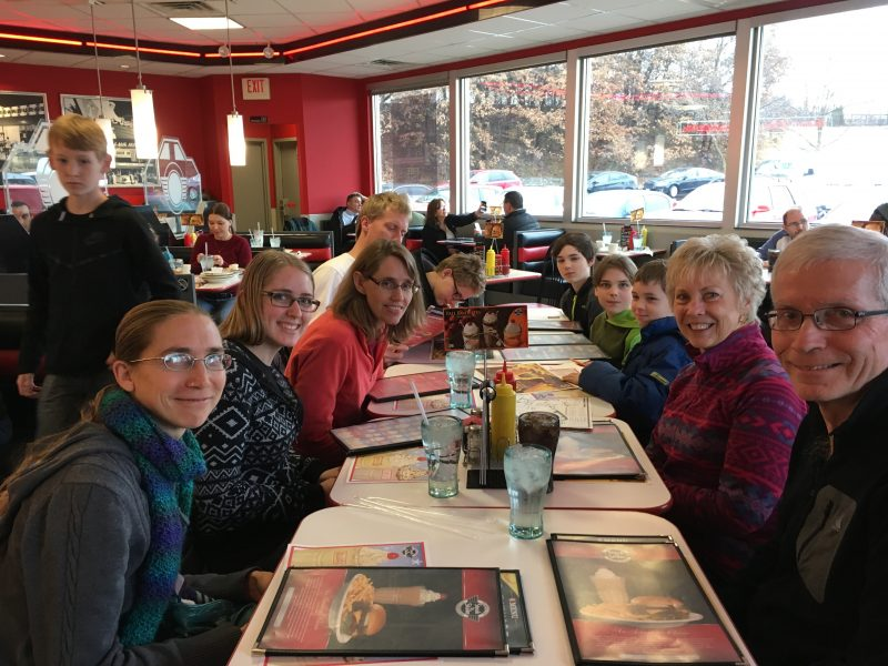 Here we are at Steak 'n' Shake, with our menus at the ready, pondering which flavor shake to order.